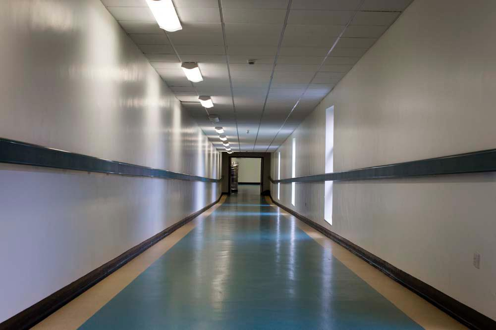 The view down a long hospital corridor