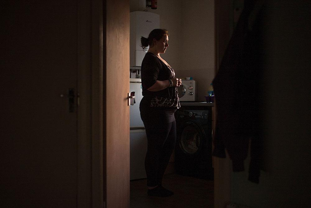 Woman stood alone in her kitchen
