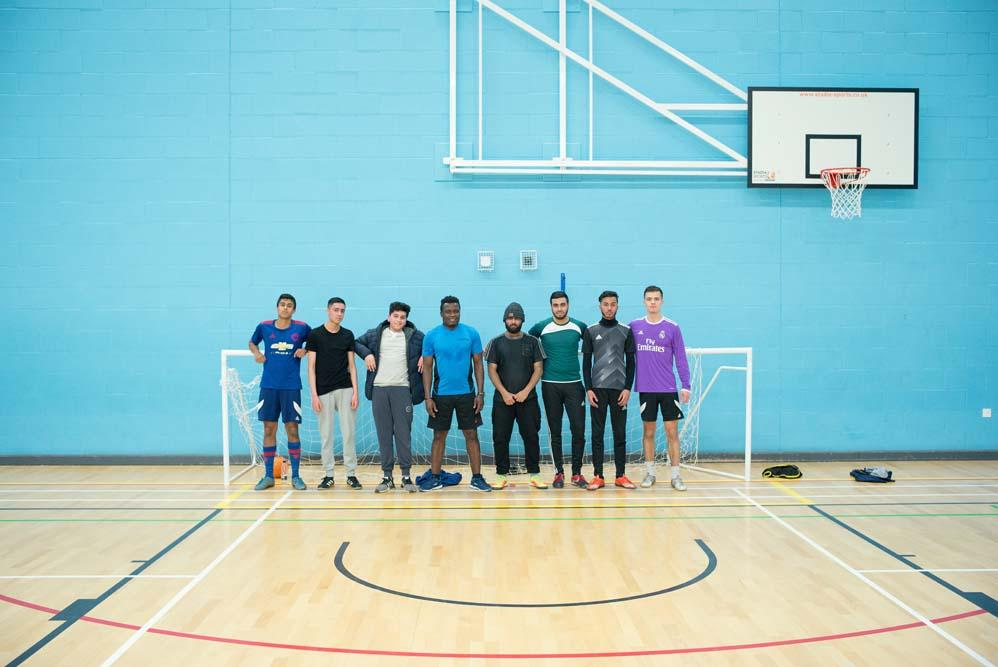 A group of footballers from Chesham standing in a Gym