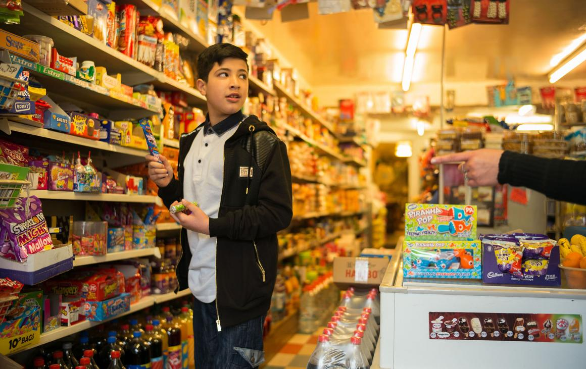 Boy in sweet shop selecting sweets
